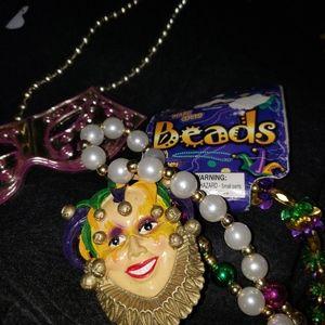 Madi gras beads and hats